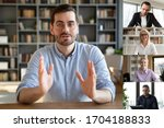 Small photo of Confident businessman team leader lead group videoconference meeting with different age and ethnicity partners, diverse people negotiating distantly working from home, full frame pc screen webcam view