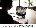Small photo of E-learning via virtual application, videocall video conferencing activity, colleagues working together concept. Pc screen view over woman shoulder, listen tutor gain new knowledge noting information