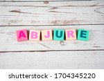 """Small photo of """"abjure""""-the words on wooden cubes. A background image of english words on colorful building blocks."""