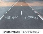 Marking a bike path on the sidewalk