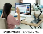 Small photo of Asian business woman say hello or goodbye to her colleagues about plan in video conference. Multiethnic business team using computer for a online meeting in video call.