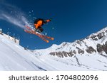 A Male Athlete Skier In An...