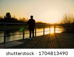 Silhouette Of Young Man...