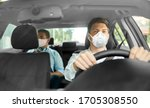 health care, safety and pandemic concept - male taxi driver driving car and passenger wearing face protective mask for protection from virus disease - stock photo