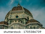 Florence, Italy, May 13th, 2016: Santa Maria del Fiore cathedral facade under reconstruction on a stormy day - stock photo