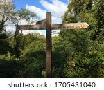 Rustic Wooden Signpost To...