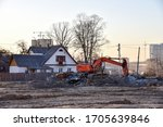 Excavator Demolishes An Old...