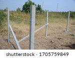 Barbed Wire Fence With Cement...