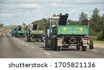 A Many Tractors Convoy With...