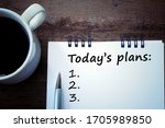 Small photo of Today s plans list with number written on notebook, a pen, and a white cup of morning coffee on a wooden table. Every organized life and business deserve planning concept.