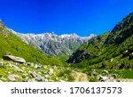 Mountain green valley landscape view. Mountain valley trail. Trail in mountains. Mountain trail view