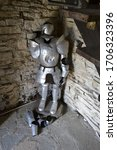 Small photo of Varenna/Italy - May 26, 2013: Aluminium made vintage medieval armament exposed inside the ancient Vezio castle for decoration purpose.