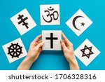 Choose religion concept. hand...