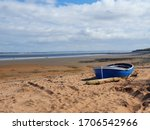 Small Abandoned Blue Boat On A...