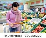 pretty caucasian woman choosing ... | Shutterstock . vector #170665220