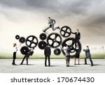 Small photo of Conceptual image of businessteam working cohesively. Interaction and unity