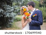 Young Couple Kissing In Weddin...