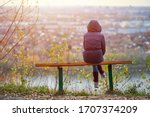 Young Woman Sitting On Bench I...