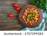 Tasty Warm Salad. Colored Pasta ...