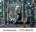 Old And Abandoned Caravan Left...