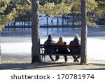 Three People Sitting On A...