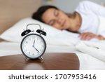Close Up Alarm Clock On Wooden...