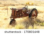 An Old Three Wheel Tractor Sit...