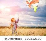 cute little girl flies a kite... | Shutterstock . vector #170812130
