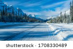 Small photo of Icy road with fir full of snow all along the road, Canada