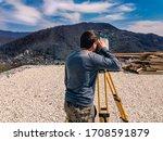 Surveyor Man With A Total...