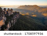 panoramic sunrise at three sisters lookout over blue mountains valley with mist new south wales australia nsw