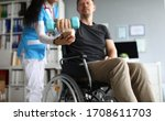 Man On Wheelchair Holds...
