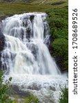 Small photo of Glencoe or Allt Lairig Eilde Falls, Glen Coe, Highland, Scotland, UK Allt Lairig Eilde joins River Coe in spate after heavy rain
