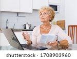 Senior Woman Searching On...