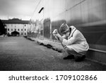 Small photo of Frightened doctor for infectious diseases having mental nervous break down.Coronavirus COVID-19 exhausted physician in fear.Working in improvised medical facility isolation ward.Medical worker stress