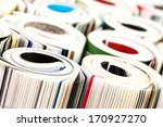 Stack of color magazines on white background - stock photo