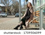 Beautiful Woman Is Sitting At A ...