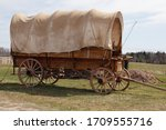 Antique covered wagon  chuck...