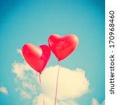 retro love balloons on blue sky | Shutterstock . vector #170968460