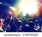 Stock photo a crowd of people at a concert focus on the phone photo 170976539