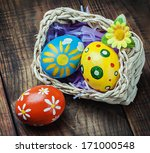 painted easter eggs in a basket ...   Shutterstock . vector #171000548