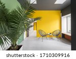 Two Armchair On A Yellow Wall....