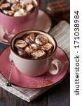 Cup of delicious hot chocolate with marshmallow on wooden background. - stock photo