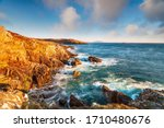 Rugged Cliffs And Swirling Seas ...