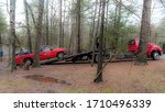 Red Pickup Truck Being Loaded...
