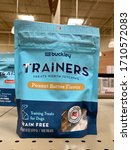Small photo of San Jose, CA - April 12, 2020: Training doggy treats by Buckley, peanut butter flavor in medium sized bag on store shelf.