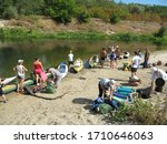 Russia, Saratov region - september, 2010: group of tourists is preparing for kayaking and Hiking - stock photo