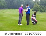 caddy pointing out a hazard to... | Shutterstock . vector #171077330