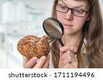 scientist examines a kaiser bun ... | Shutterstock . vector #1711194496