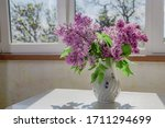 Vase With Fresh Lilac Flowers...